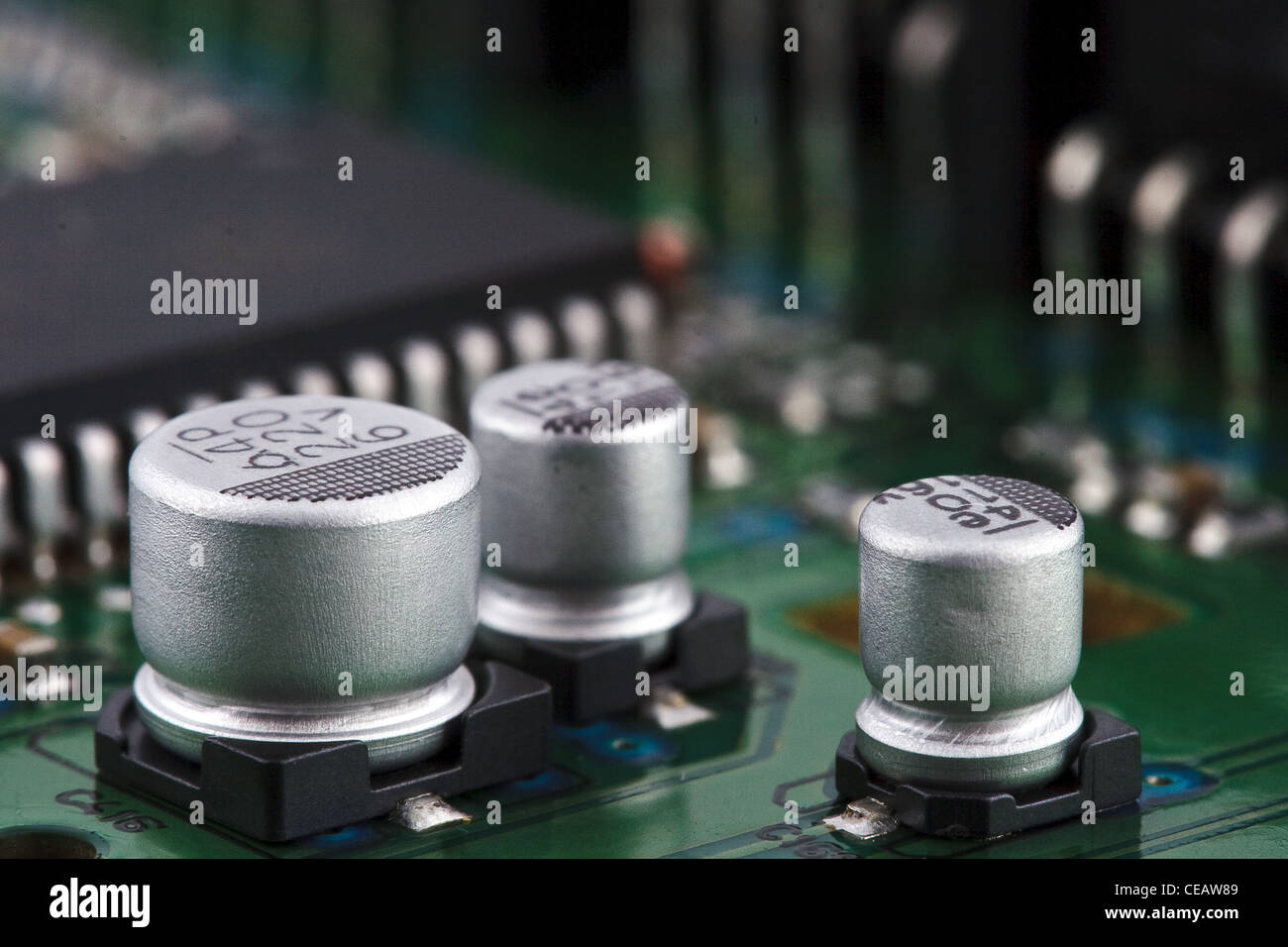Capacitors on circuit board - Stock Image