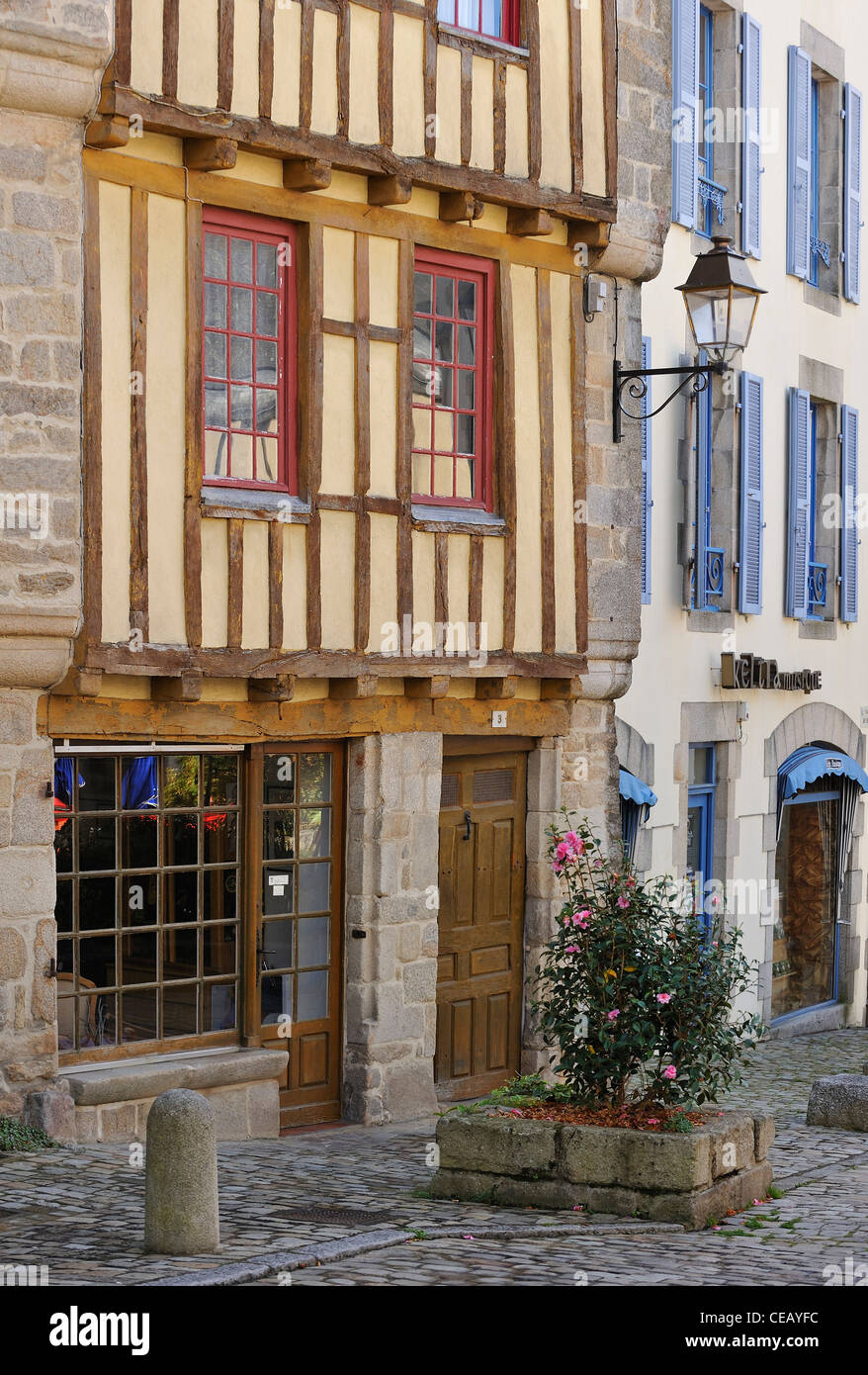Street with half-timbered houses in the historic old town of Quimper, Finistère, Brittany, France - Stock Image