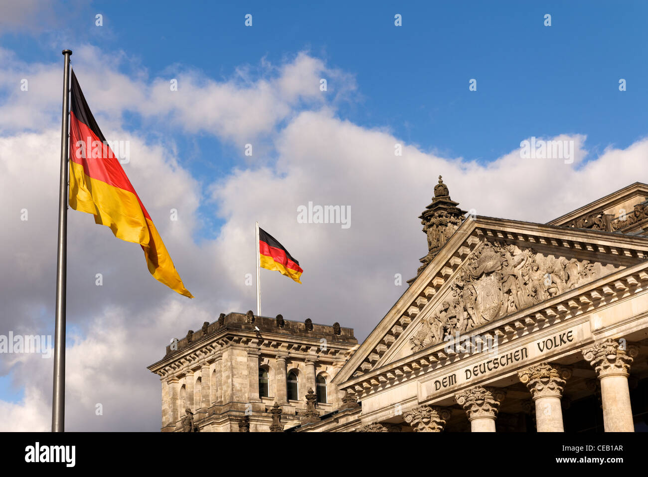 German flags flying at the Reichstag, the seat of the Bundestag, the German Federal Parliament. - Stock Image