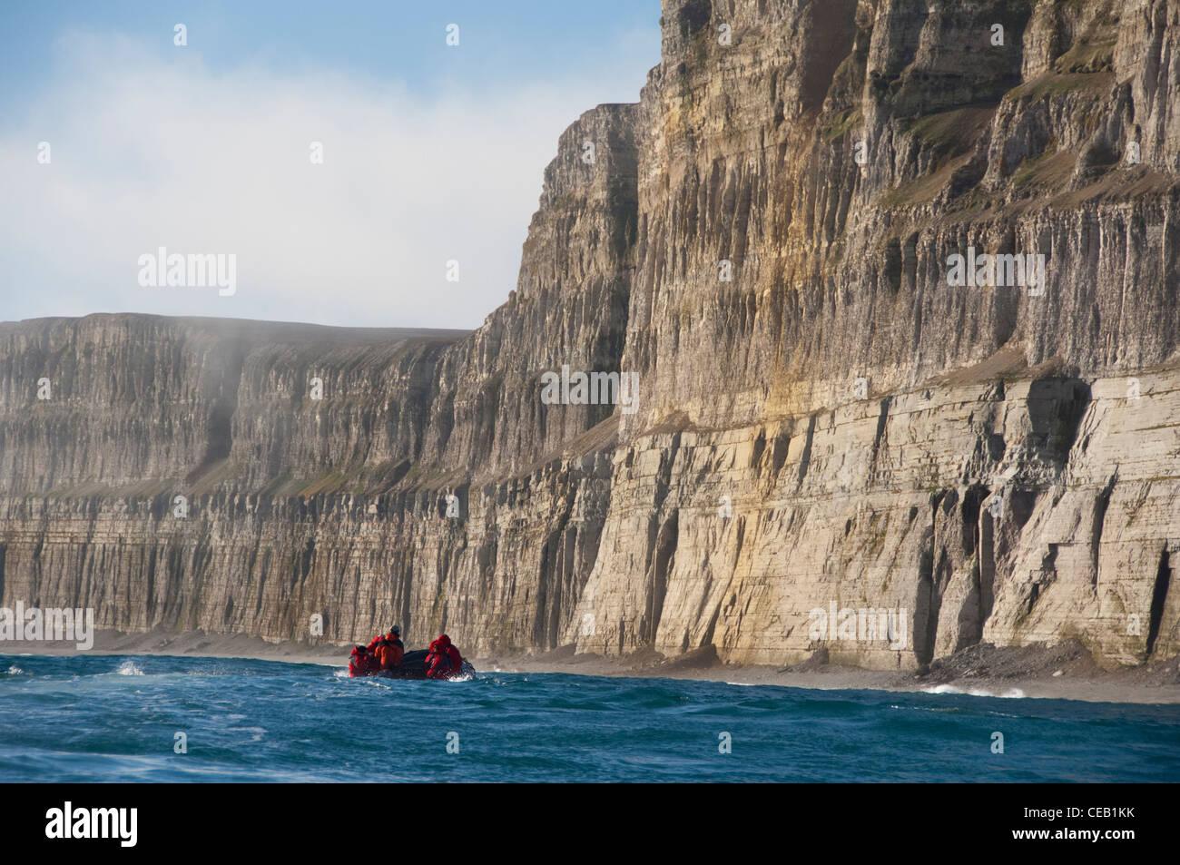 Canada, Nunavut, Qikiqtaaluk Region, Akpatok Island. Tourists in zodiac looking for stranded Polar bears. - Stock Image
