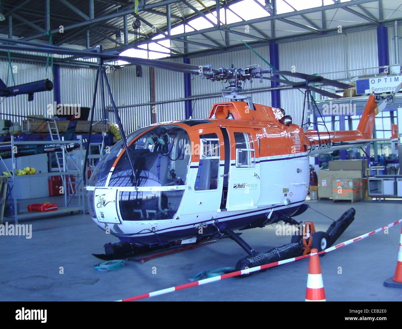 MBB Bo 105 helicopter with registration D-HARO in a hangar at the airfield of Bremerhaven - Stock Image