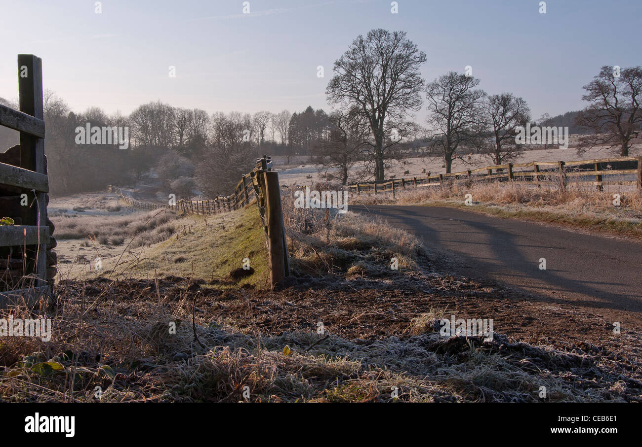 The road from Tunstall reservoir to Wolsingham situated in Weardale in County Durham on a frosty winters morning - Stock Image