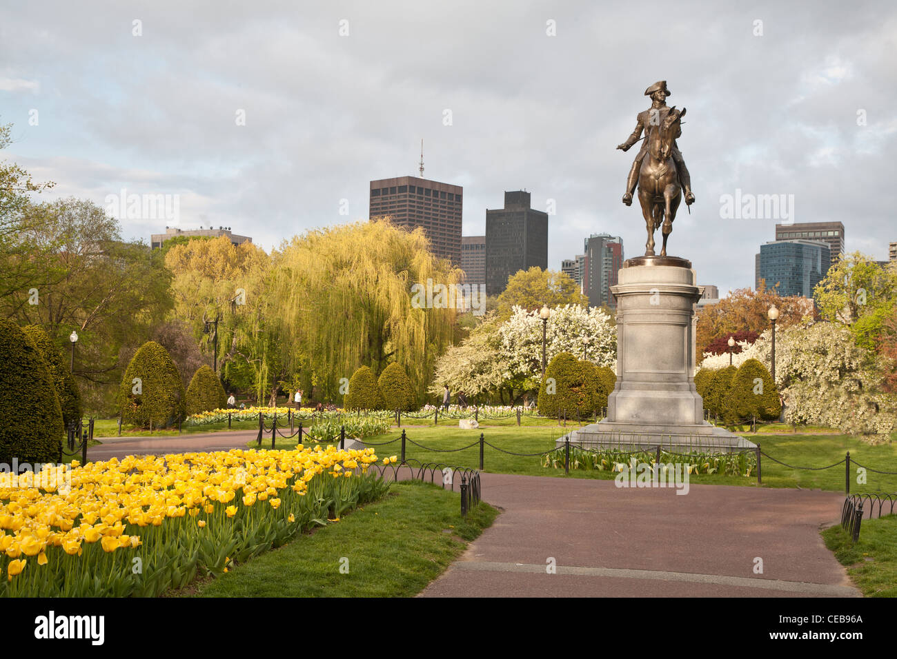 Boston Public Garden in spring with yellow tulips and statue of George Washington - Stock Image