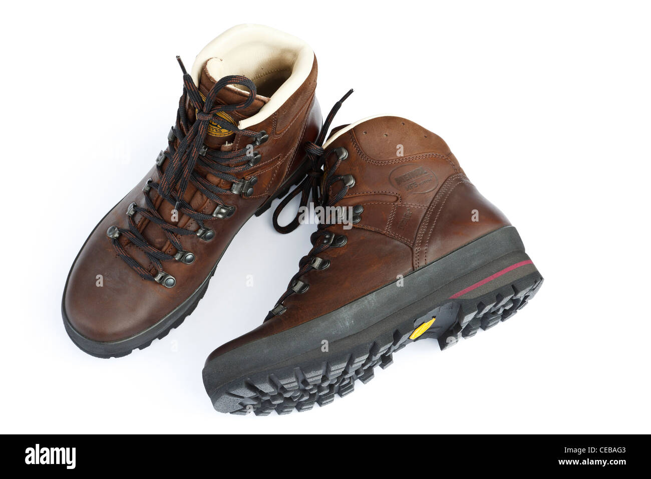 9ba1aacb3915 One pair of traditional brown leather walking boots or hiking boots by  Meindl with a Vibram rubber sole isolated on a white background from above