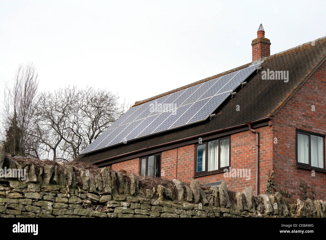 Solar power panels on new housing - Stock Image