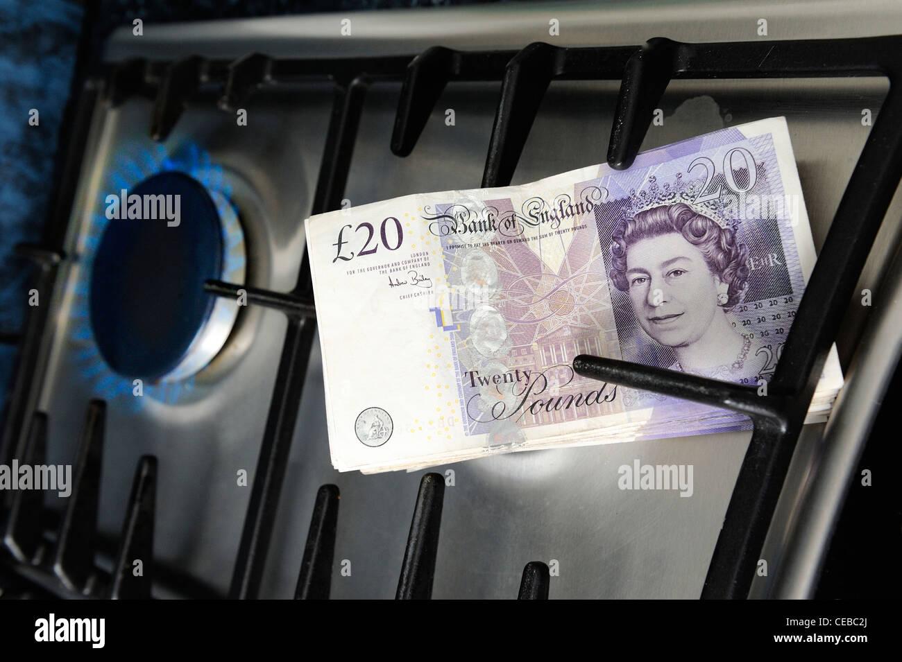 gas hob with english 20 pound note england uk - Stock Image