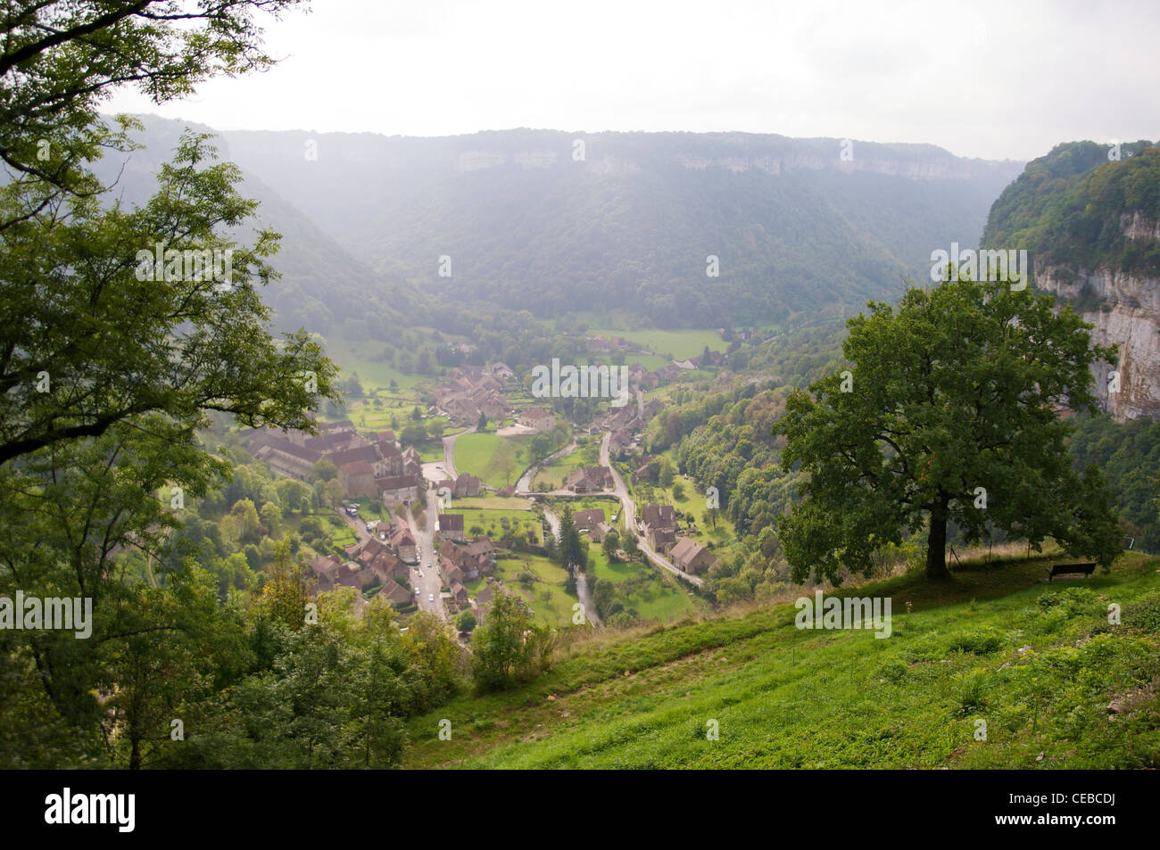 View of Baume-les-Messieurs with the Baume Abbey and the river Seille. - Stock Image