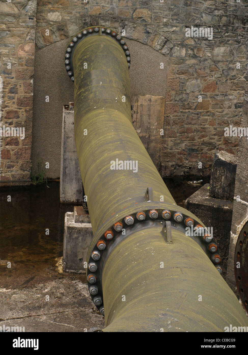 Nuts and bolts holding industrial water pipes together Stock Photo