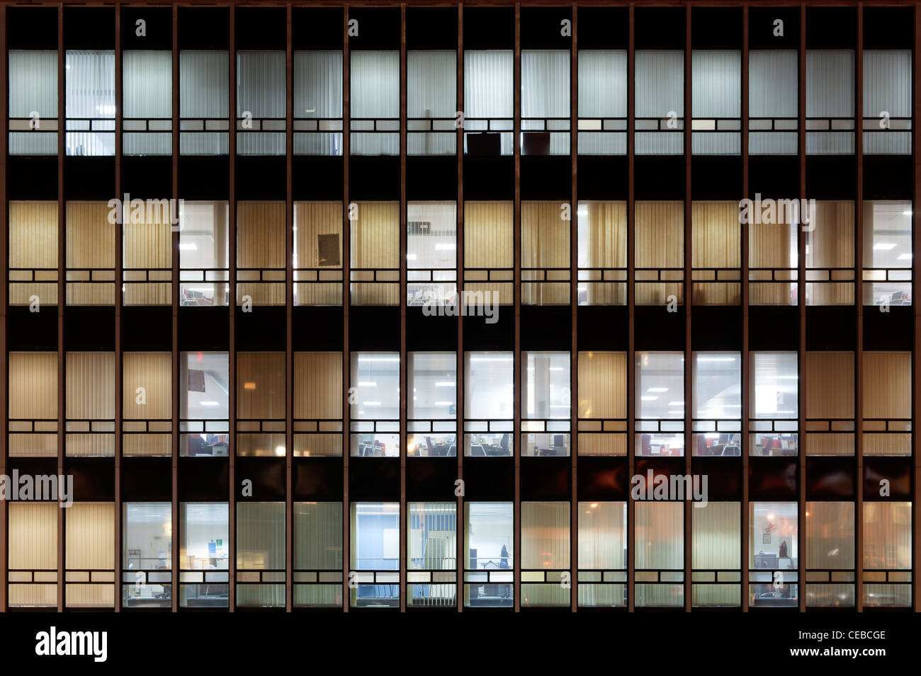 The grid windows of the CIS Tower offices located on Miller Street, Manchester, taken at night. - Stock Image