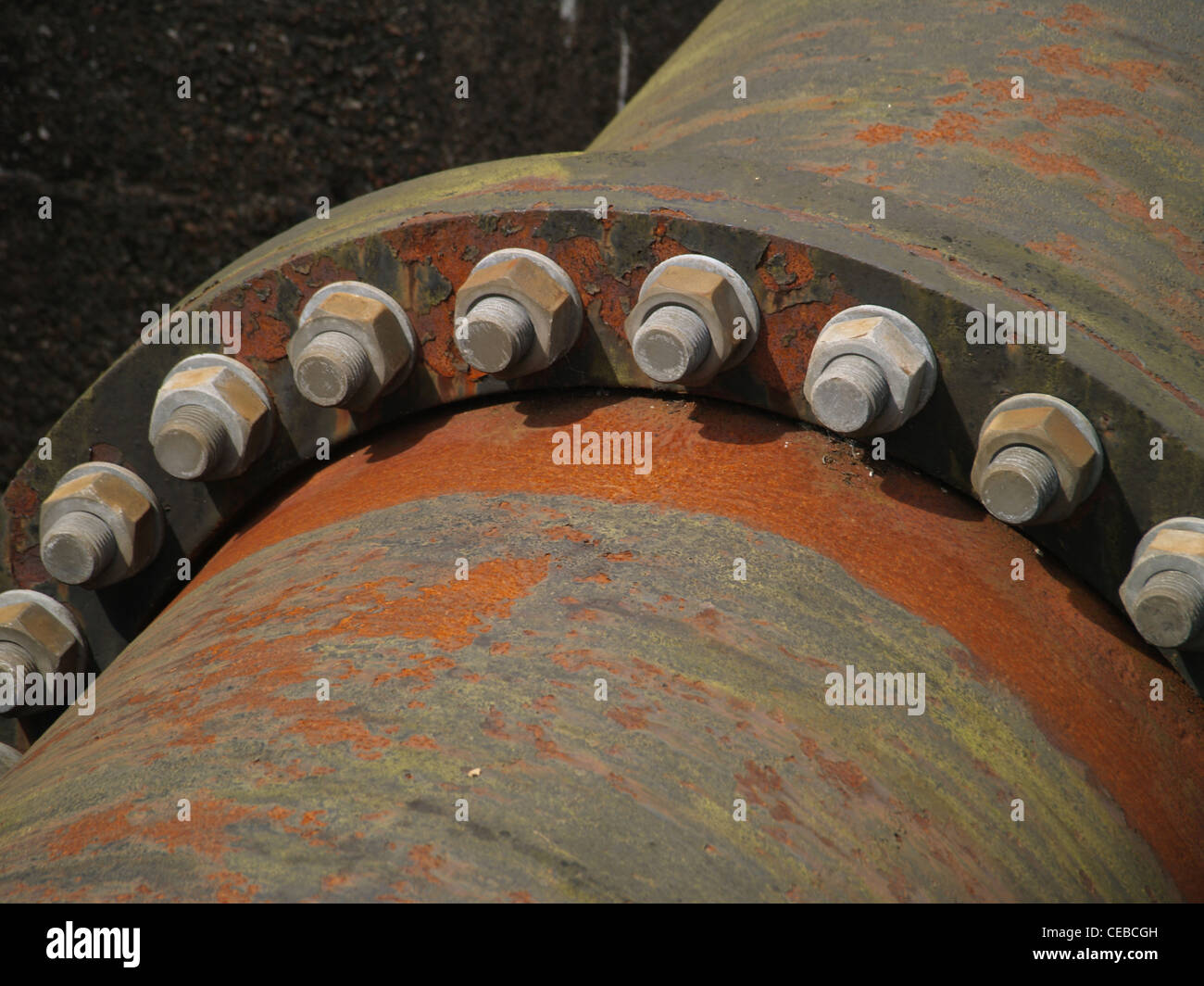 Nuts and bolts holding industrial sized water pipes together Stock Photo