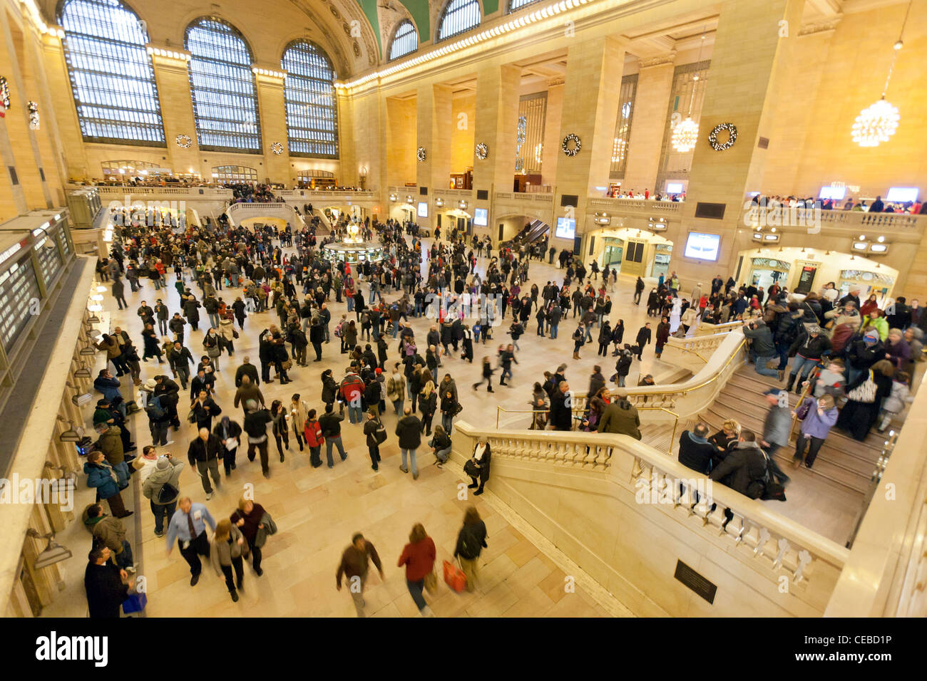 An interior view of Grand Central Station in New York City with all the travelers. - Stock Image