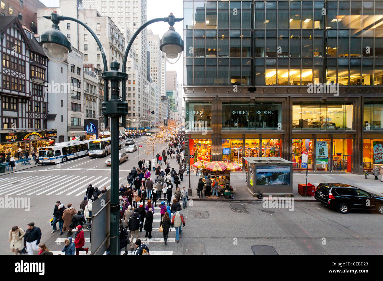 Shoppers and pedestrians walking on Fifth Ave in New York City. - Stock Image