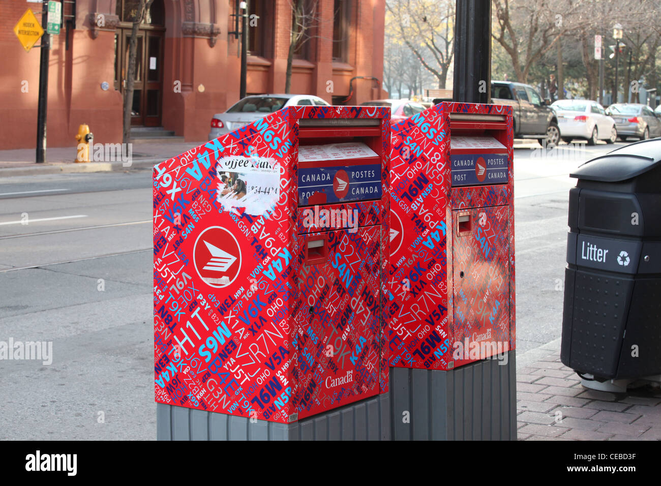 Mail box with Canadian postal codes on Toronto street - Stock Image