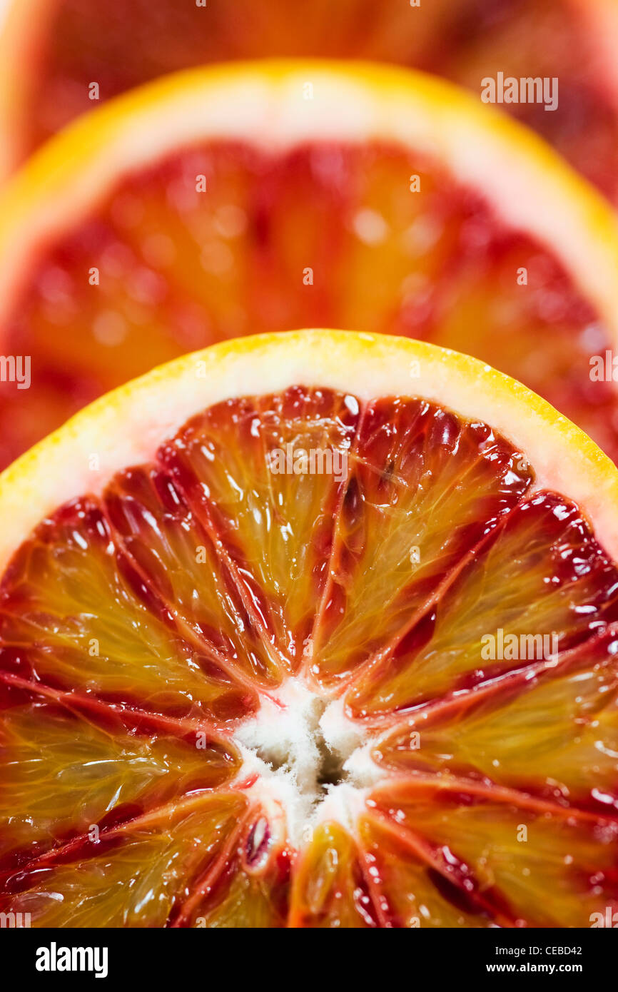 Citrus x sinensis. Close up of blood orange halves. Stock Photo