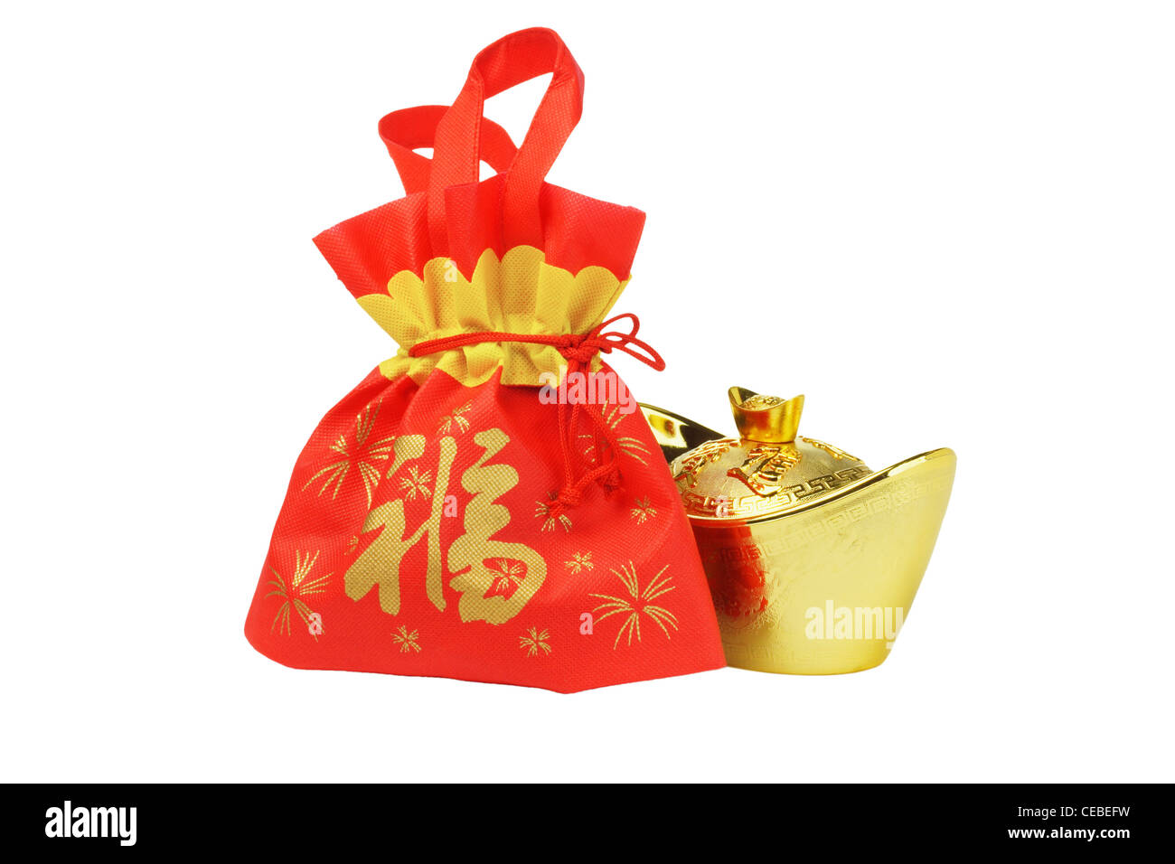 Chinese New Year Gift Bag and Gold ingot Ornament on White Background - Stock Image
