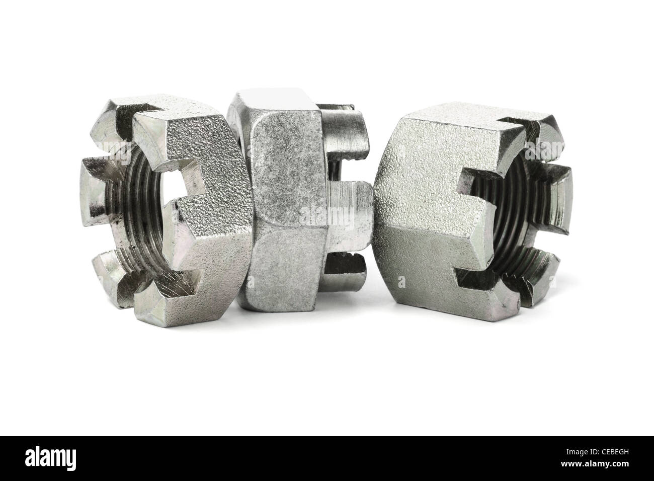 Three Hexagonal Metal Nuts on White Background - Stock Image