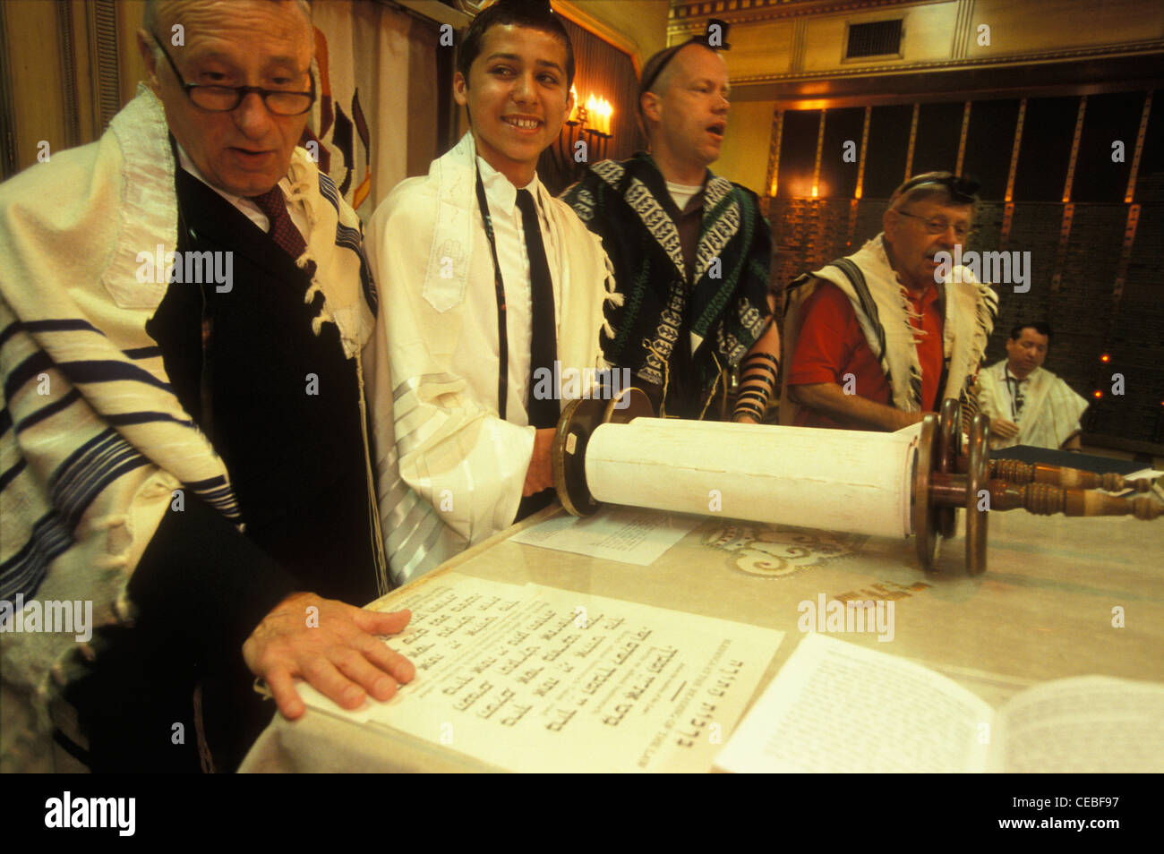 Male family members and the cantor assists a Jewish boy at  his bar mitzvah at Fair Lawn Jewish Center, New Jersey, - Stock Image