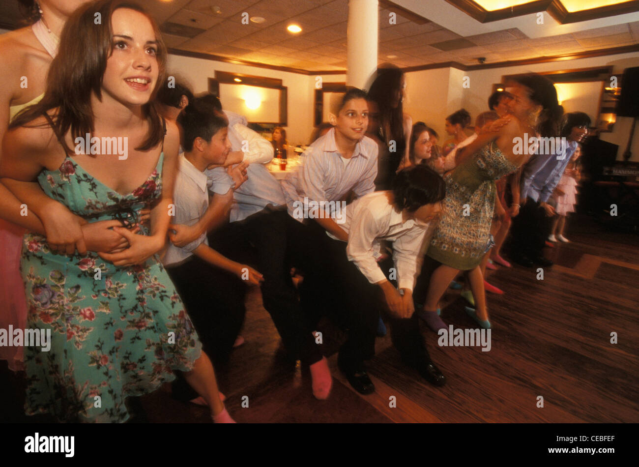 Young friends and relatives of a Jewish girl play games at her bat mitzvah party in a restaurant in New Jersey, - Stock Image