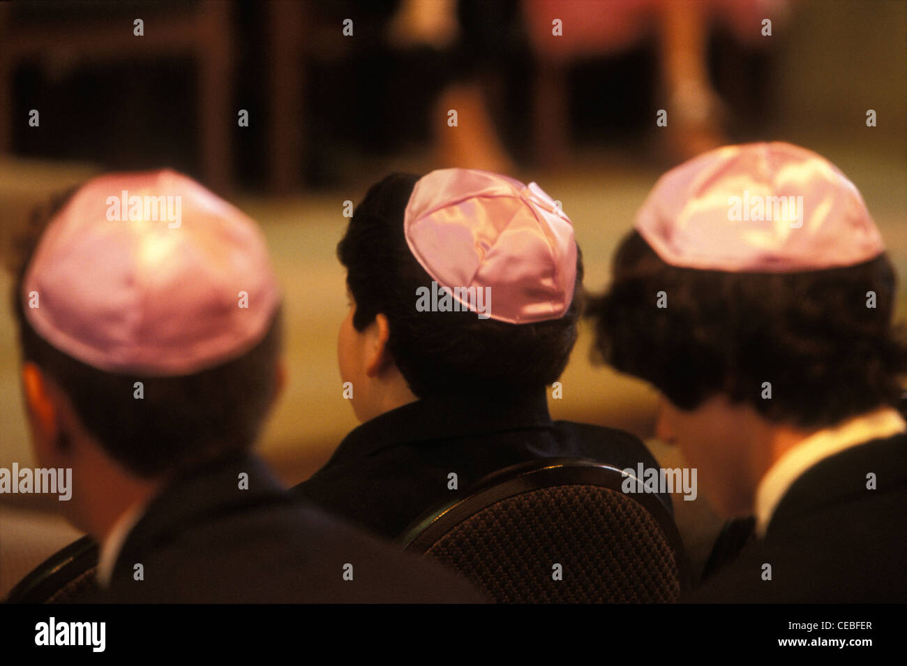 Boys dressed in kippah at a Jewish girl's bat mitzvah, her coming-of-age ritual, at Temple Avoda in Fair Lawn, - Stock Image