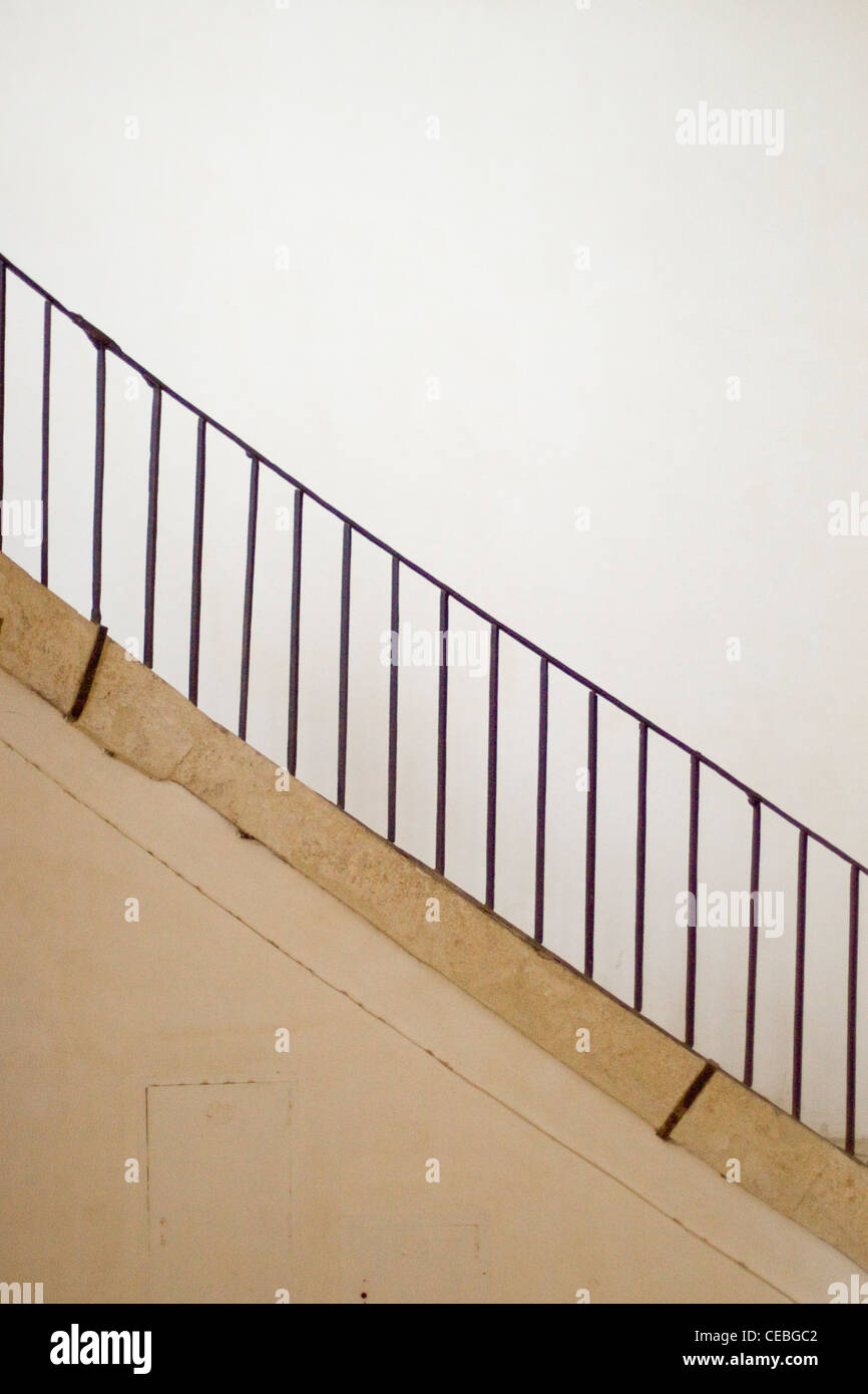 Flight of Stairs with an iron hand rail - Stock Image