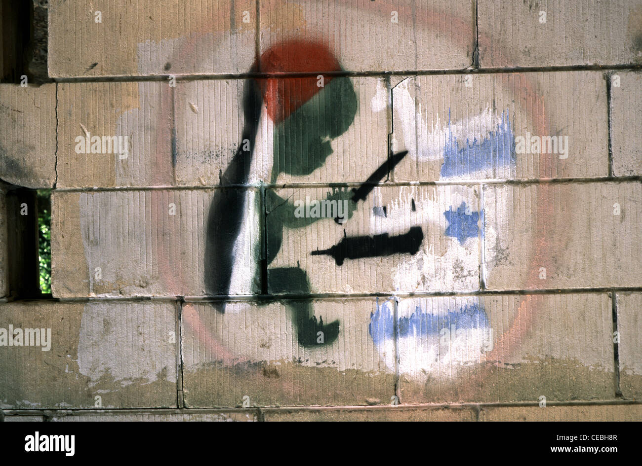 Cryptic drawing on a wall depicting Intifada conflict in Israel - Stock Image