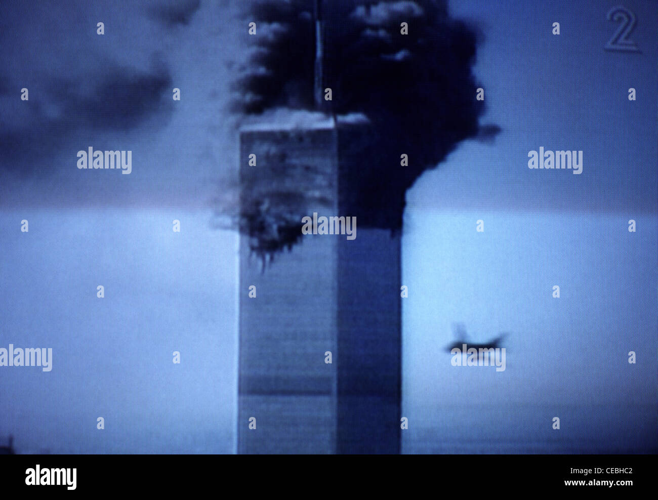 A screen shot of television's live coverage of events unfolding in New York during 9/11 - Stock Image