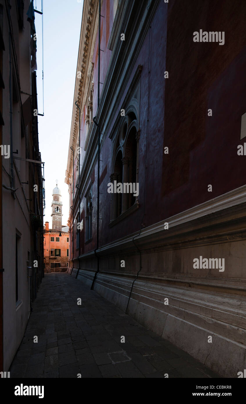 The bell tower of San Pantalon church at the end of a narrow sreet, Venice, Italy - Stock Image