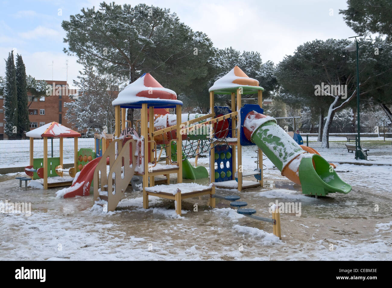 Colourful play area for children, Spinaceto district, after the exceptional snow fall occurred on February 2012, - Stock Image
