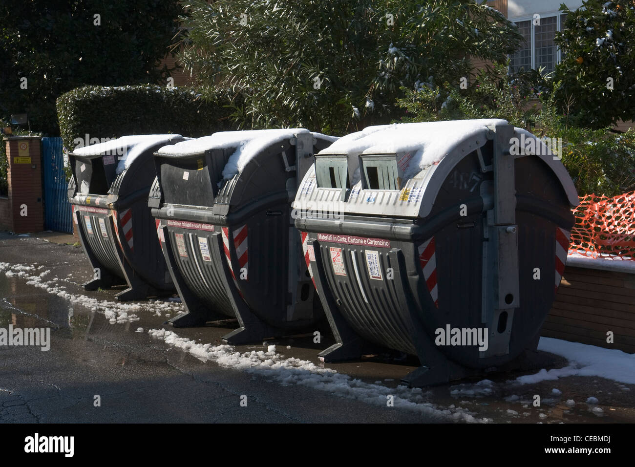 Rubbish bins showing the rare snowfall occurred in Rome on February 4th, 2012 - Stock Image