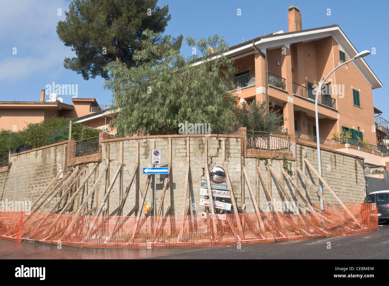 Temporary wooden support for an unsafe wall in Rome, Italy - Stock Image