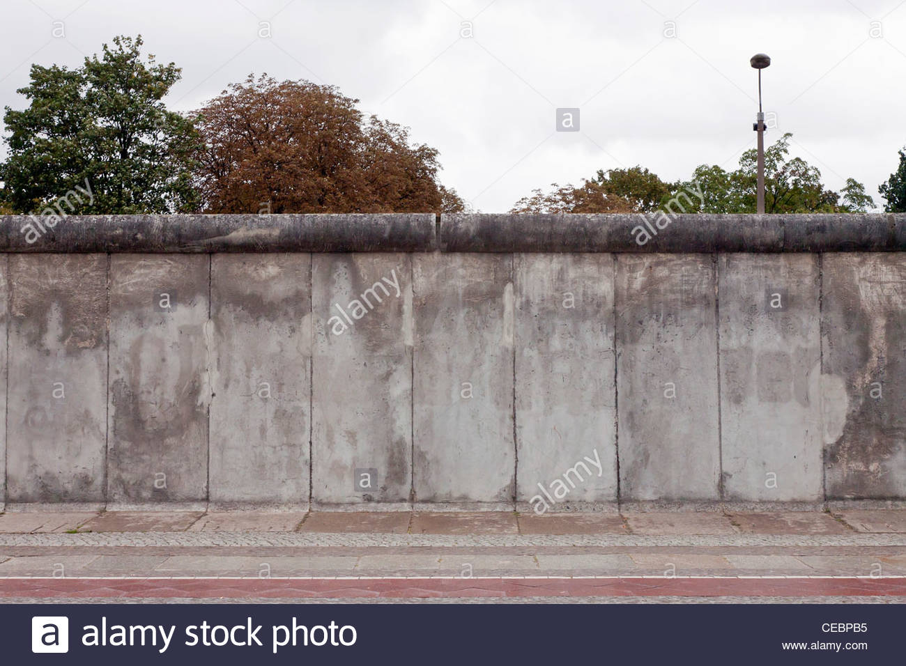 A preserved section of the Berlin Wall in front of the Berlin Wall Memorial, Berlin, Germany, Europe - Stock Image