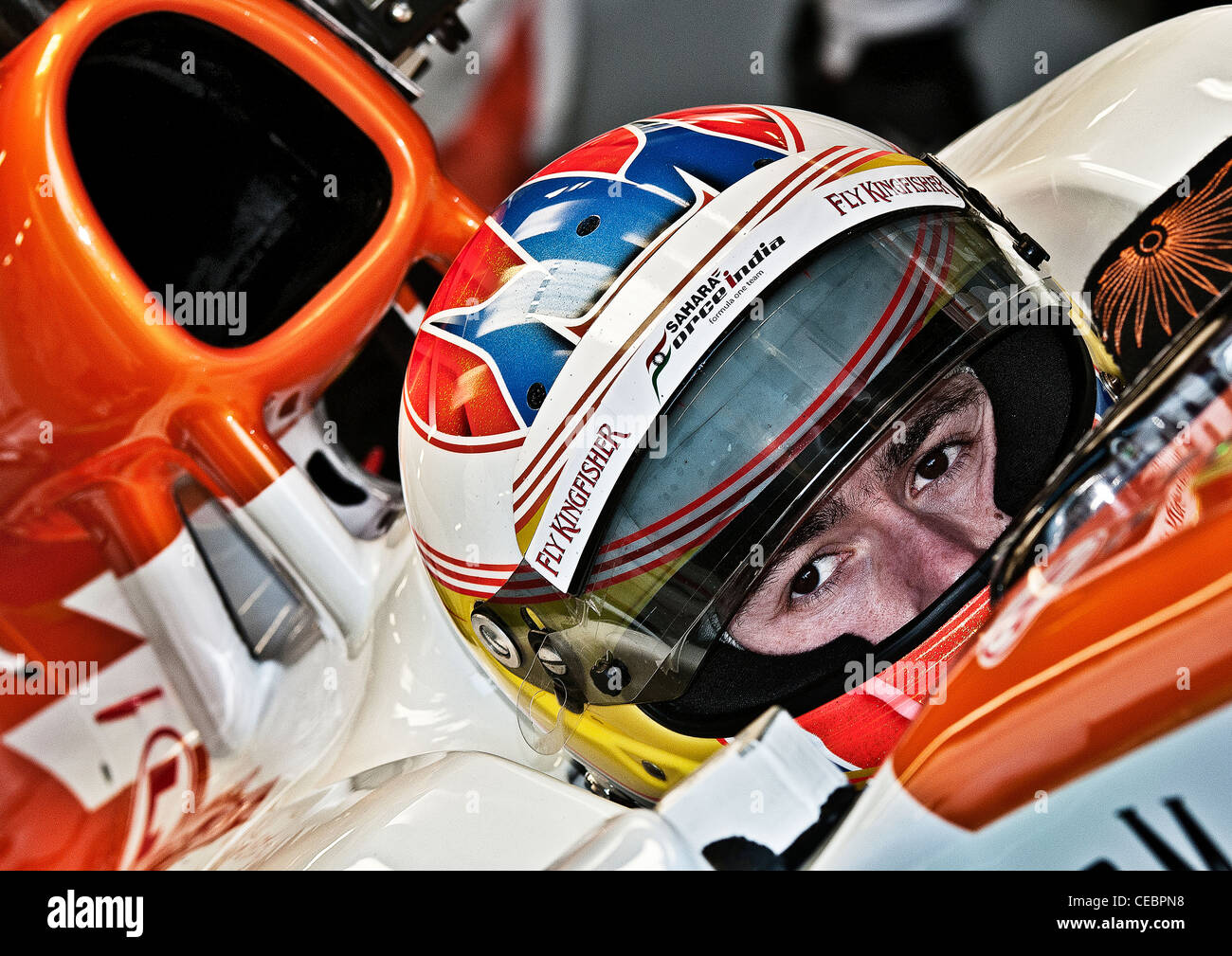 Paul Di Resta waiting patiently in his car while his mechanics get ready for his first run in the 2012 VJM05 Sahara - Stock Image