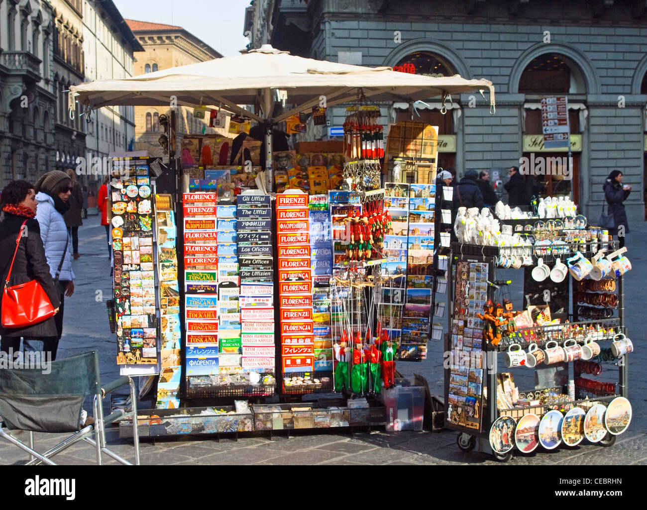 A stall selling Guide Books and souvenirs in the Piazza San Giovanni, Florence, Italy - Stock Image