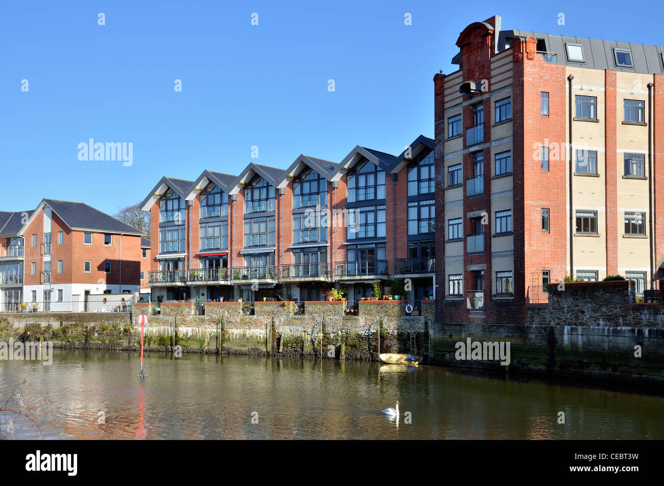 Riverside homes in Truro, Cornwall, the building used to be a warehouse before it was converted into apartments. - Stock Image