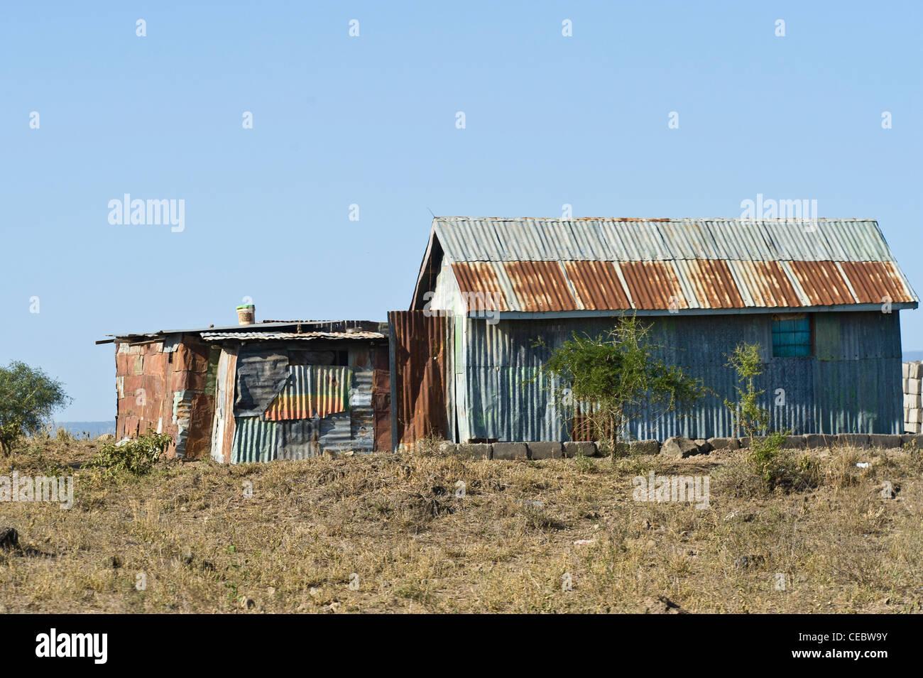 House built with corrugated sheet iron Arusha Tanzania - Stock Image