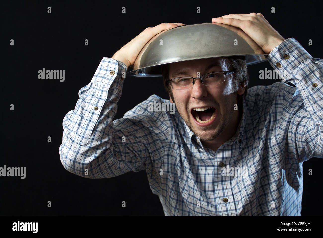 Shouting Man With Bowl On Head - Stock Image