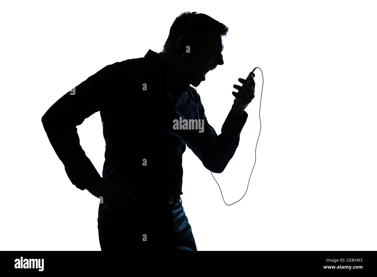 one caucasian man  telephone videophone  portrait silhouette in studio isolated white background - Stock Image