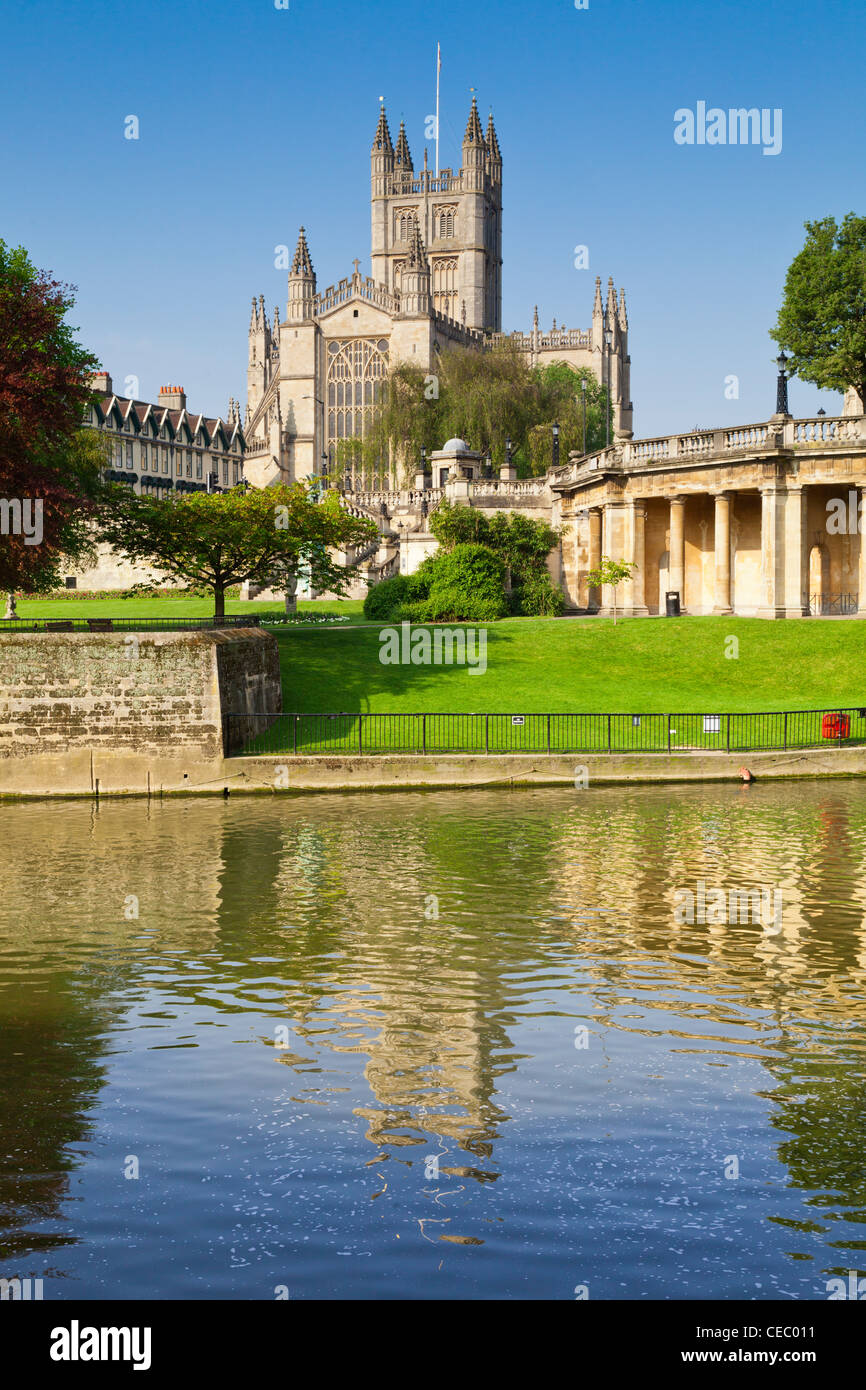 Bath Abbey, reflected in the River Avon in spring. - Stock Image