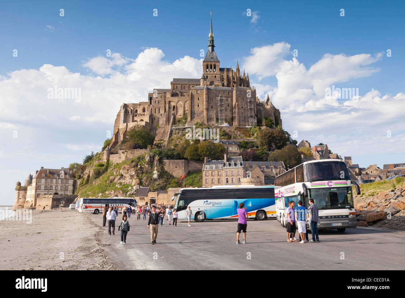 Tour coaches and tourists at Mont-St-Michel, Normandy, France. - Stock Image