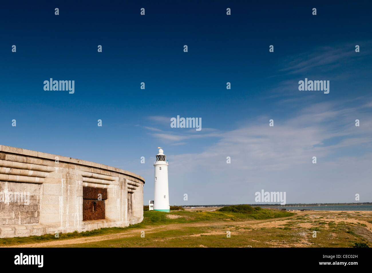 The lighthouse at Hurst Point, on the Solent in Hampshire, England. - Stock Image