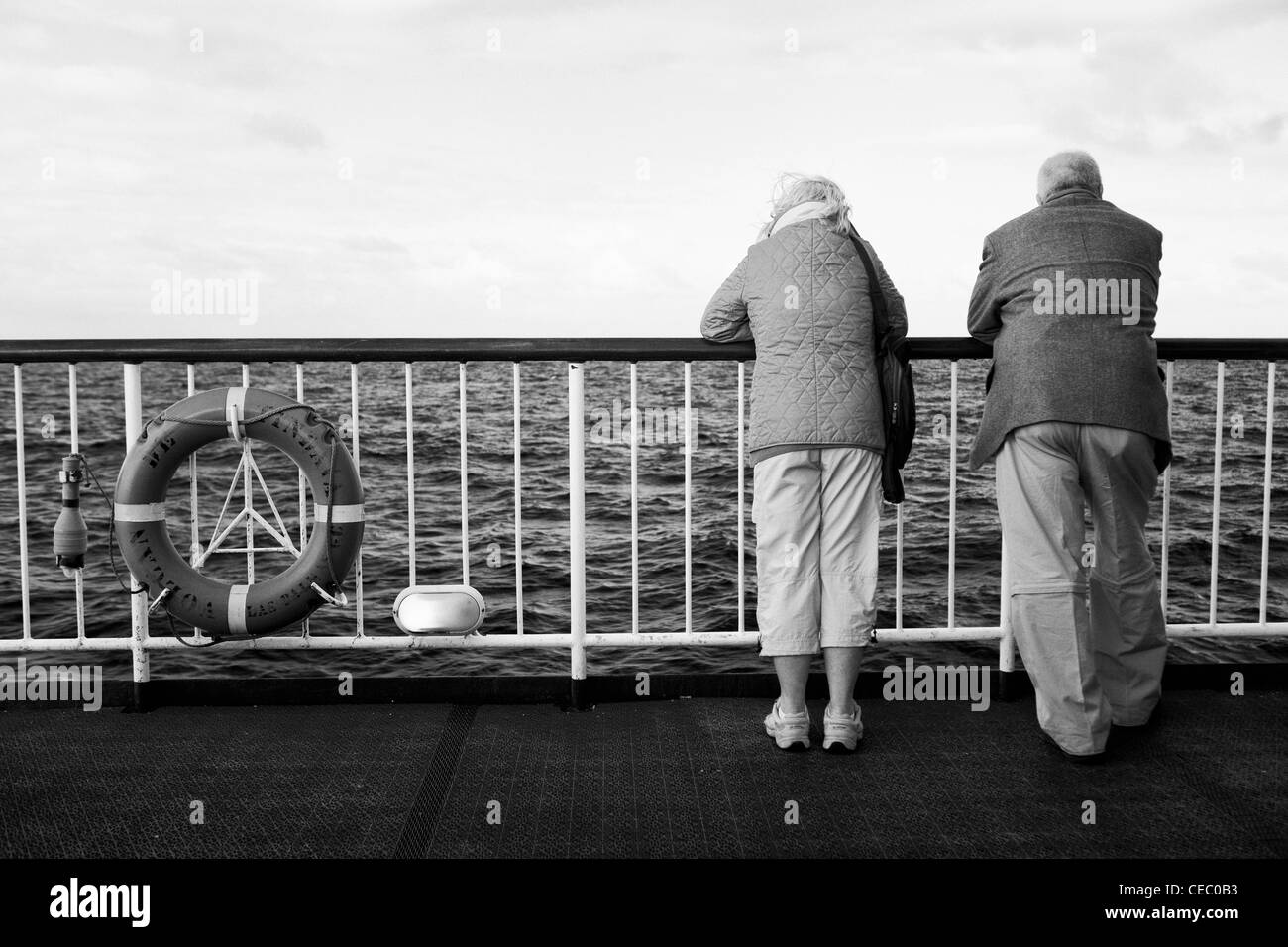 Elderly people enjoying early retirement during a boat trip - Stock Image