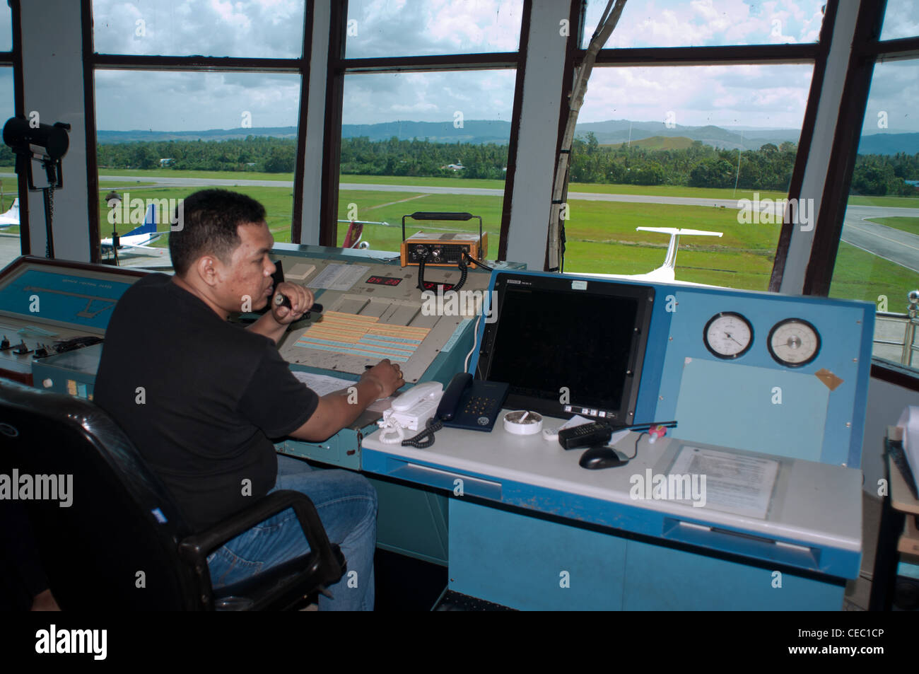 Air traffic controllers are generally individuals who are well organized, are quick with numeric computations and - Stock Image