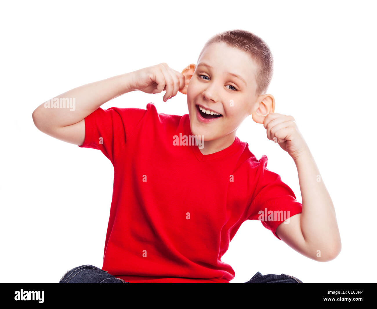 naughty child making faces, isolated against white background Stock Photo