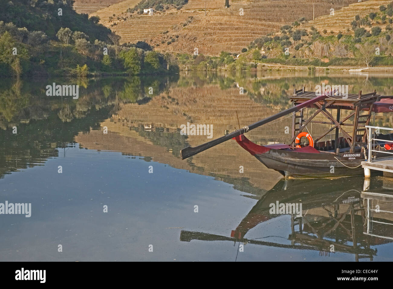 PORTUGAL, River Douro, Pinhao, view on river bank with barca rabelo (traditional boat for transporting port barrels) Stock Photo