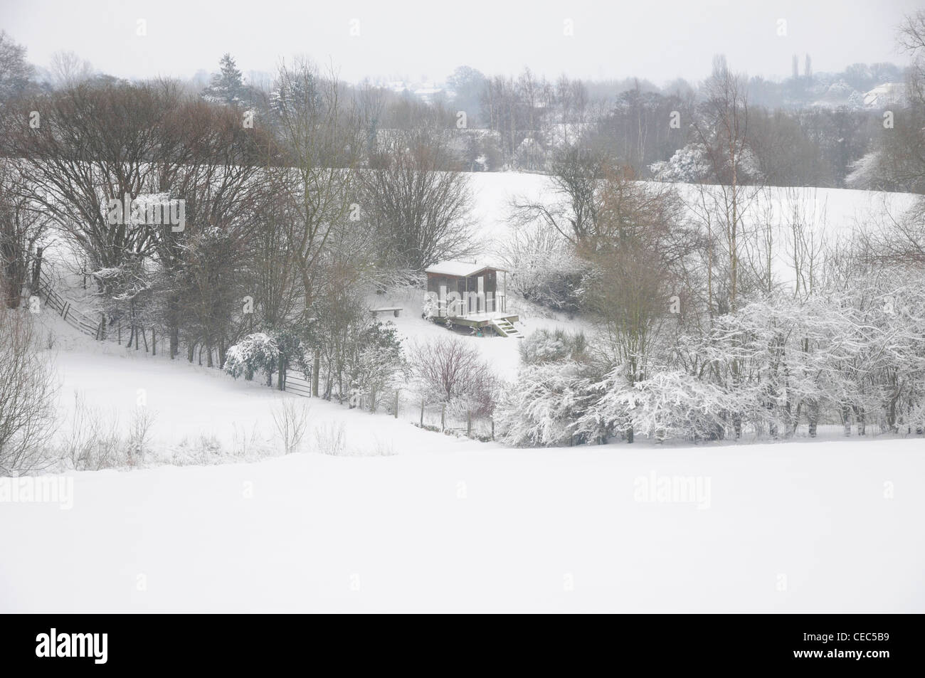 Summerhouse in winter snow landscape, UK - Stock Image