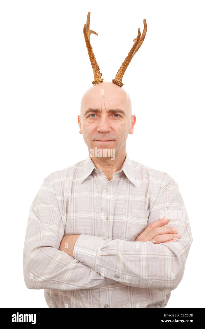 man with antlers on head on white - Stock Image