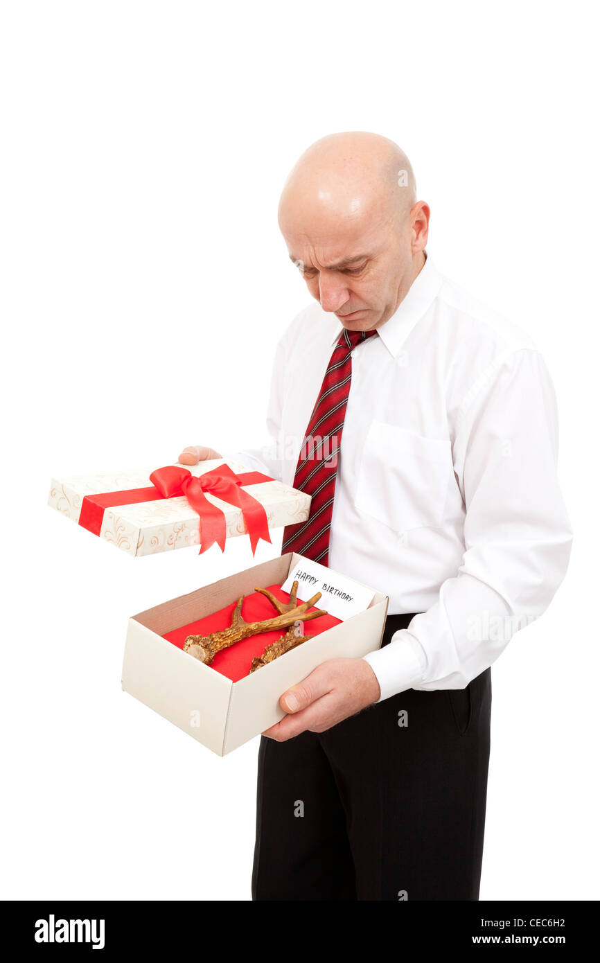 husband receive antlers in gift - Stock Image