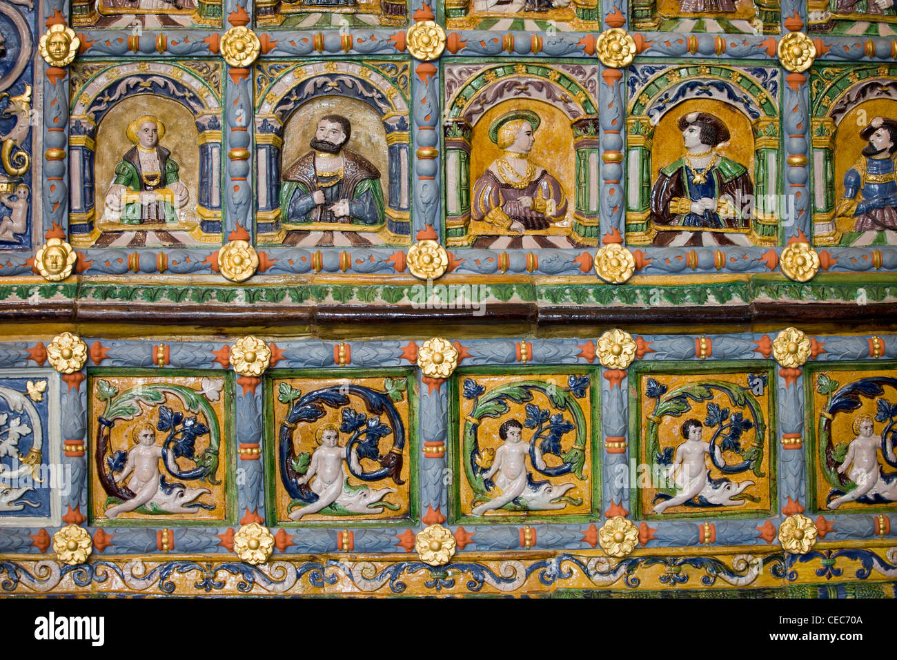 Ornate tiles on the tiled stove in the Artus Court in Gdansk, Poland - Stock Image