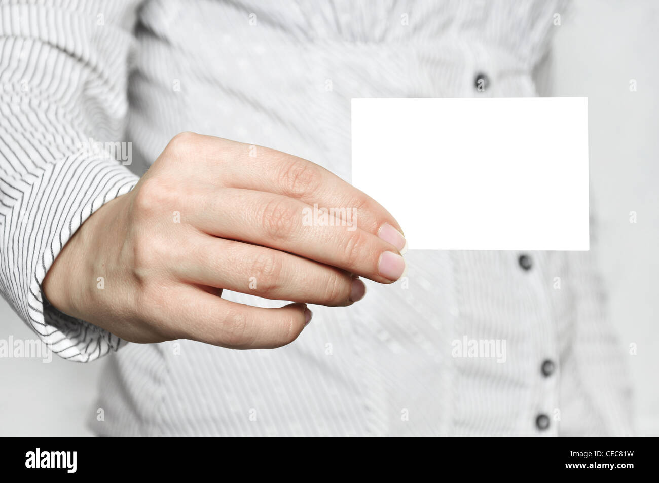 Businesswoman showing and handing a blank business card Stock Photo ...