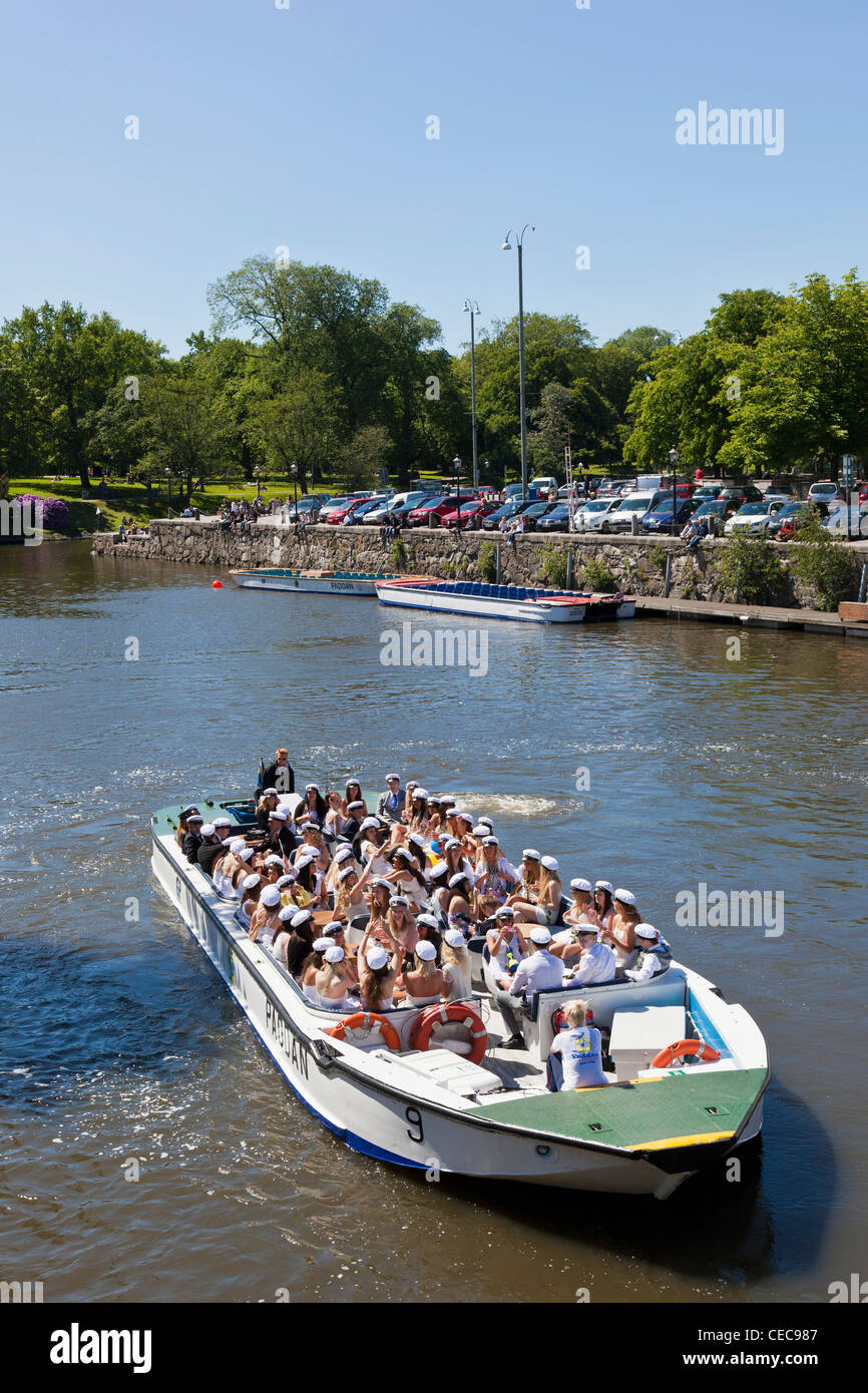 Happy students who celebrate the student with a canal trip in Gothenburg with the boat Paddan - Stock Image